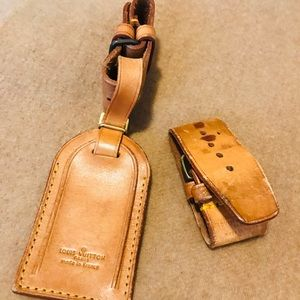 Authentic Louis Vuitton tag and poignets